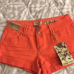 Coral colored jean shorts